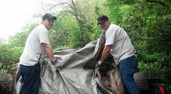 Mario Beccone, left, and William Anderson help keep the landscape at The Maryland Zoo looking beautiful.