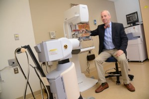 Dr. Rick Hudes, chief of radiation oncology at Saint Agnes Hospital, uses AccuBoost technology, shown here with a mammogram machine, to make radiation treatments for breast cancer patients safer and more accurate. Saint Agnes is the only Maryland hospital that has AccuBoost. (The Daily Record/Maximilian Franz)
