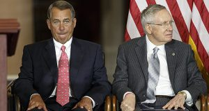 "House Speaker John Boehner of Ohio, left, sits with Senate Majority Leader Harry Reid of Nev., on Capitol Hill in Washington, as Congress honored victims of the terror attacks of September 11, 2001, during a ""Fallen Heroes of 9/11 Gold Medal Ceremony."" The House and Senate are controlled by different political parties, but both are spending time these days on similar paths: debating measures that everyone knows are going nowhere. (AP Photo/J. Scott Applewhite)"