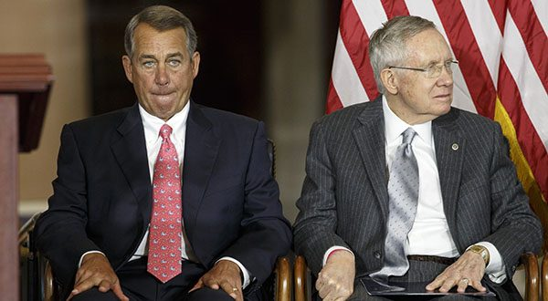 """House Speaker John Boehner of Ohio, left, sits with Senate Majority Leader Harry Reid of Nev., on Capitol Hill in Washington, as Congress honored victims of the terror attacks of September 11, 2001, during a """"Fallen Heroes of 9/11 Gold Medal Ceremony."""" The House and Senate are controlled by different political parties, but both are spending time these days on similar paths: debating measures that everyone knows are going nowhere. (AP Photo/J. Scott Applewhite)"""