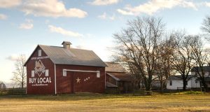 """A Barn in Harford County that was painted with a sign encouraging residents to 'Buy Local"""". (The Daily Record/Maximilian Franz),"""