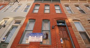 A home for sale on Portland Street in Baltimore, where officials hope a new tax credit will keep homeowners in the city. (The Daily Record/Maximilian Franz)
