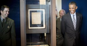 President Barack Obama walks toward the original manuscript of the 'Star Spangled Banner' during his tour of Fort McHenry Visitor and Education Center in Baltimore, Friday, Sept. 12, 2014. With Obama are Vincent Vaise, left, National Parks Service Ranger and Chief of Interpretation at Ft McHenry and Burt Kummerow, CEO of Maryland Historical Society. Obama traveled to the historic site that is celebrating the 200th anniversary of the Battle of Baltimore and will also attend a private Democratic fundraiser before returning to Washington. (AP Photo/Pablo Martinez Monsivais)