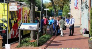 "Entrepreneurs line up outside of the Startup Maryland Bus in Frederick MD to pitch their business ideas to investors. If you have to have a credit for the image, you could use ""City of Frederick Economic Development."" (Photo: City of Frederick)"