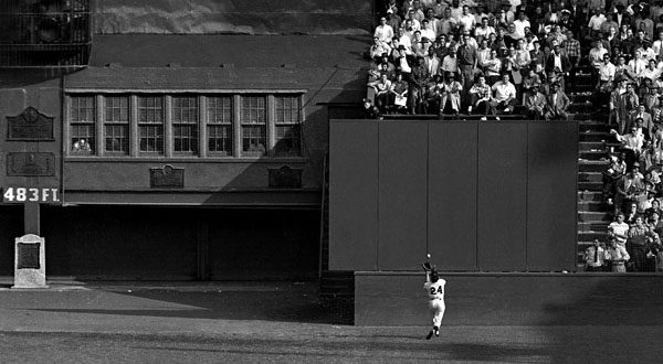 Willie Mays making his legendary catch on September 29, 1954, during Game 1 of the 1954 World Series between the New York Giants and the Cleveland Indians.