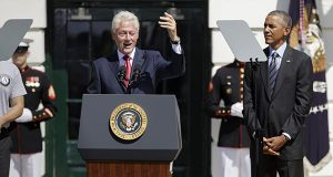 President Barack Obama listens as former President Bill Clinton speaks during a ceremony on the South Lawn of the White House in Washington, Friday, Sept. 12, 2014. (AP Photo/J. Scott Applewhite)