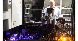 Stefan Hell, winner of the Nobel Prize in chemistry stands behind the microscope he developed at the Max Planck Insitute in Goettingen, central Germany, Wednesday, Oct. 8, 2014. Hell shares the prize with US-Americans Eric Betzig and William E. Moerner for developing ways to dramatically improve the resolution of optical microscopes. (AP Photo/Hubert Jelinek)