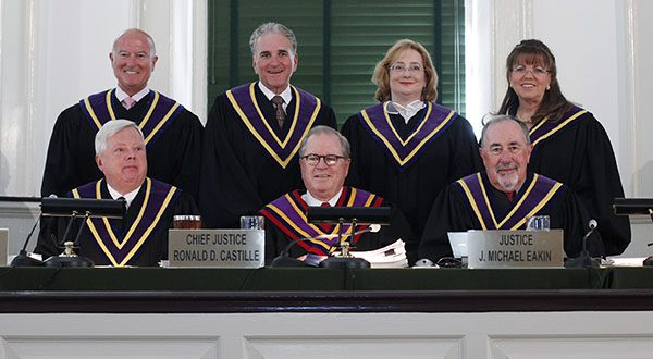 In this Sept. 13, 2011, file photo, justices of the The Pennsylvania Supreme Court pose for photographs at Philadelphia's historic Old City Hall. Justices from top left: Seamus P. McCaffery, Max Baer, Debra McCloskey Todd, Joan Orie Melvin. From lower left: Thomas G. Saylor, Chief Justice Ronald D. Castille, and J. Michael Eakin. (AP Photo/Matt Rourke, File)