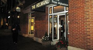 This Oct. 22, 2014 photo shows a nighttime exterior of The Helmand, a restaurant in Baltimore that serves Afghan cuisine. The restaurant is owned by Qayum Karzai, the brother of the former Afghan president Hamid Karzai. The menu includes aushak, which are silky noodles stuffed with leeks; mantwo, stuffed meat pastries; and two kinds of Afghan ice cream. (AP Photo/Beth J. Harpaz)
