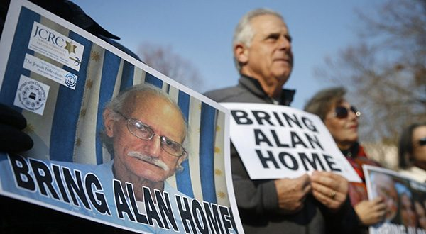 Supporters of Alan Gross, on poster at left, last year marked his fourth year in a Cuban prison with a protest in Lafayette Park, across from the White House. (AP Photo/Charles Dharapak, File)