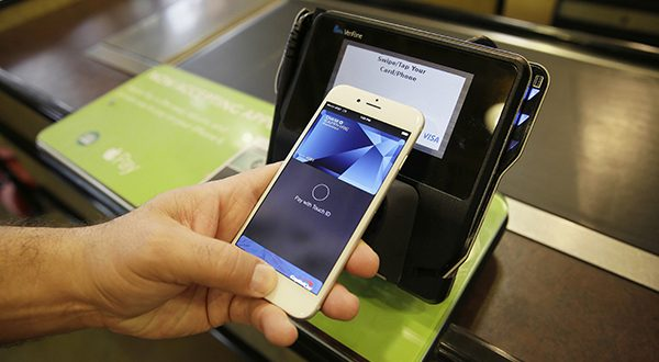 Apple Pay, shown here, is among the mobile pay systems accepted at more than 200,000 locations in the U.S., but millions more, including smaller merchants, don't have the technology. (AP PHOTO/ERIC RISBERG, FILE)