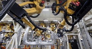 Robots install rivets on a 2015 Ford F-150 truck at the Dearborn Truck Plant in Dearborn, Mich., Tuesday, Nov. 11, 2014. The Commerce Department releases business inventories for September on Friday, Nov. 14, 2014. (AP Photo/Paul Sancya)