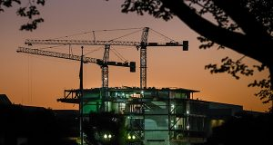 Construction cranes are silhouetted against the early morning sky as work continues on Smithsonian's new National Museum of African American History and Culture in Washington. The Commerce Department releases construction spending for September on Monday, Nov. 3, 2014. (AP Photo/J. David Ake)
