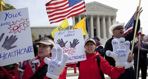 In this March 28, 2012 file photo, protesters chant in front of the Supreme Court in Washington as the court concludes three days of hearing arguments on the constitutionality of President Barack Obama's health care overhaul, the Patient Protection and Affordable Care Act. (AP Photo/Carolyn Kaster, File)