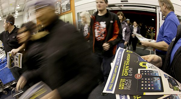 In this November, 2013 file photo, shoppers enter a Best Buy as the store opens on Thanksgiving Day, in Overland Park, Kan. Despite positive economic signs, holiday shoppers will only spend if they get big discounts. (AP Photo/Charlie Riedel, File)