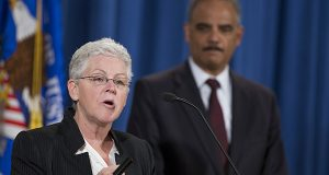 Attorney General Eric Holder listens at right as Environmental Protection Agency Administrator Gina McCarthy speaks during a news conference at the Justice Department in Washington, Monday, Nov. 3, 2014. The Justice Department and EPA announced that Hyundai Motor Company and Kia Motors Company would pay a $100 million penalty for overstating vehicle fuel standards. (AP Photo/Evan Vucci)