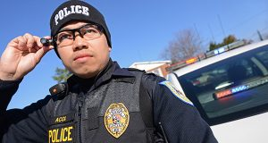 Officer Alfie G. Acol, with the Laurel Police Department, connects his head mounted-point of view video recording system to the docking station that charges and downloads the video from the unit. A Washington, D.C. man filed a lawsuit Thursday, alleging that Alcol performed an illegal and public strip search during a traffic stop. (The Daily Record/Maximilian Franz)