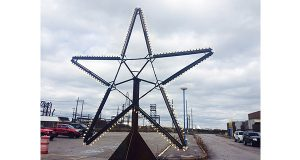 Star of Bethlehem that adorned the L Blast Furnace at Sparrows Point was placed in the parking lot outside of the terminal's career development center before a ceremony honoring former workers on Monday. (The Daily Record/Adam Bednar)