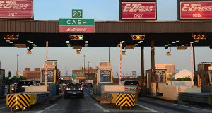 Traffic through area highway tolls, like this complex at the Fort McHenry Tunnel in Baltimore, is expected to be heavy for the holiday, though a forecasted winter storm may dampen motorists' enthusiasm for the road. (File photo)