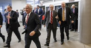 Senators, from left, Sen. Mark Pryor, D-Ark., Sen. Bob Corker, R-Tenn., Sen. James Risch, R-Idaho, Sen. John McCain, R-Ariz., and Sen. Orrin G. Hatch, R-Utah, rush to the Senate floor on Capitol Hill in Washington for a procedural vote to advance a massive defense policy bill. (AP Photo/J. Scott Applewhite, File)