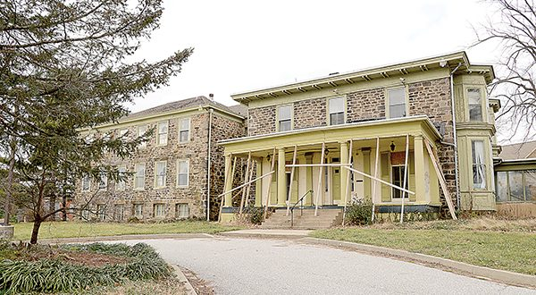 A developer plans on converting the Crittendon Mansion into apartments and building townhomes on the site as part of a $2.6 million project. (The Daily Record/Maximilian Franz)