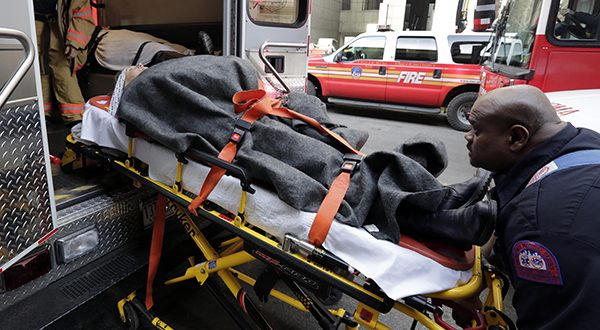 An injured passenger of a New Jersey ferry is loaded into an ambulance, in New York. Nearly 20 percent of U.S. consumers have unpaid medical debts, according to a new report released Thursday, Dec. 11, 2014 by the Consumer Financial Protection Bureau. The findings suggest that many Americans lack the financial resources to pay for health emergencies and that the notices from hospitals and insurance companies about the cost of treatment are confusing and baffling. (AP Photo/Richard Drew, File)