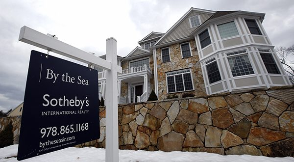 This March 21, 2014 photo shows a home for sale in North Andover, Mass. Freddie Mac, the mortgage company, releases weekly mortgage rates on Thursday, Dec. 4, 2014. (AP Photo/Elise Amendola, File)