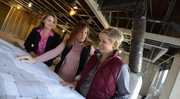 From left, Nicole Ames, director of marketing and business development; Cindy Hunt, facilities   manager; and Catherine Steiner, member, all of Pessin Katz Law P.A., look at plans for their Towson office's renovation.