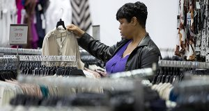 A woman shops at the Century 21 Department Store in Philadelphia. The Commerce Department releases retail sales data for October on Thursday, Dec. 11, 2014. (AP Photo/Matt Rourke)