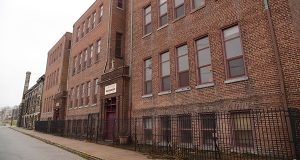 Plans to renovate the former St. Katherine School on North Rose Street into apartments for social service clients mirror similar projects to rehab abandoned school buildings in the city. (The Daily Record/Maximilian Franz)