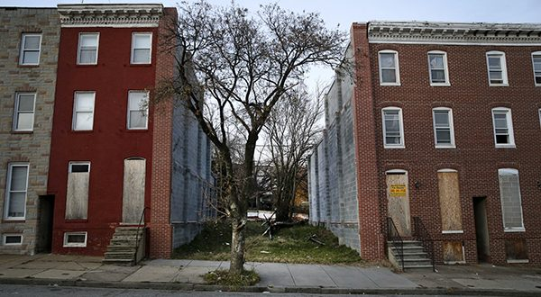 In this Dec. 29, 2014 photo, vacant land sits where a row house that belonged to homeowner Bobby Chen once stood in Baltimore. The U.S. Supreme Court on Monday refused to reinstate Chen's case after the court was unable to reach him. Chen wrote in court documents that he'd been renovating the building when the city demolished it in November 2008, claiming it was unsafe after a crew demolished an adjacent building. (AP Photo/Patrick Semansky)
