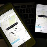 This Friday, Nov. 21, 2014 file photo taken in Newark, N.J., shows smart phones displaying Uber car availability. A new law meant to regulate and tax ride-sharing services like Uber and Lyft will need to be clarified when legislators reconvene in Annapolis in January. (AP Photo/Julio Cortez, File)