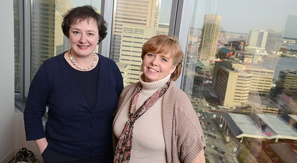 While senior paralegal Cindy Hines, right, says younger attorneys are more likely to handle things like revisions and email, Renée Lane-Kunz, chief operating officer at the same firm, says it's less a function of age than of personality: 'You can have associates who are much younger … who are still very needy,' she says. (The Daily Record/Maximilian Franz)