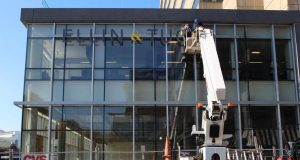 Signage being installed outside of the Ellin & Tucker's new office space on Pratt Street. (Photo courtesy of  Vitamin)