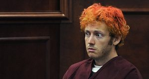 In this July 23, 2012 file photo, James Holmes, who is charged with killing 12 moviegoers and wounding 70 more in a shooting spree in a crowded theatre in Aurora, Colo., in July 2012, sits in Arapahoe County District Court in Centennial, Colo. Holmes' trial is set to start on Tuesday, Jan. 20, 2015.  (AP Photo/Denver Post, RJ Sangosti, Pool, File)