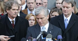 Former Virginia Gov. Bob McDonnell, center, composes himself as he addresses the media outside federal court in Richmond, Va., Tuesday, Jan. 6, 2015. McDonnell was sentenced to two years prison and two years probation in his corruption case. His attorney's Henry Asbill, left and John Brownlee, right, look on. McDonnell is to report to prison by Feb. 9. His wife, who was convicted on eight counts of corruption, will be sentenced Feb. 20. (AP Photo/Steve Helber)