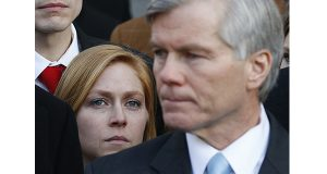 Backed by his daughter, Cailin Young, former Virginia Gov. Bob McDonnell addressed the crowd outside federal court in Richmond after his sentencing Jan. 6. (AP Photo/Steve Helber)