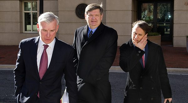 New York Times reporter James Risen, center, leaves federal court in Alexandria, Va., on Jan. 5. At the time, prosecutors called Risen a critical witness in their case against ex-CIA officer Jeffrey Sterling. (AP Photo/Cliff Owen)