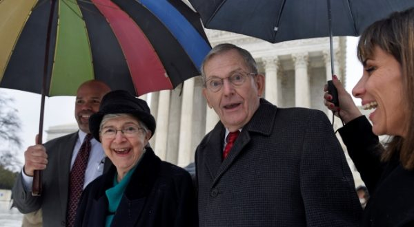 Good News Community Church Pastor Clyde Reed, center, smiles as he leaves the Supreme Court on Monday with his wife Ann, left.  (AP Photo)