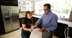 ConnectRealty.com realtor Greg Gammonley, right, shows off a home to prospective buyer Maddie Coker last year in Orlando, Fla. (AP file photo)