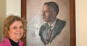 Alexa Fraser remembers her father as 'a joy of life,' like in the youthful portrait of him in her Rockville home. At 90, he killed himself after suffering from Parkinson's disease. This has sparked Fraser to advocate for the right to physician-assisted 'death with dignity' in Maryland. (Grace Toohey/Capital News Service)