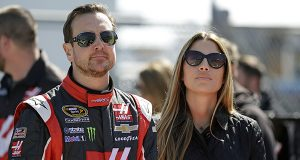 Driver Kurt Busch, left, with his girlfriend Ashley Van Metre before getting in his car during qualifying for the Daytona 500 NASCAR Sprint Cup Series auto race at Daytona International Speedway, Sunday, Feb. 15, 2015, in Daytona Beach, Fla. (AP Photo/John Raoux)