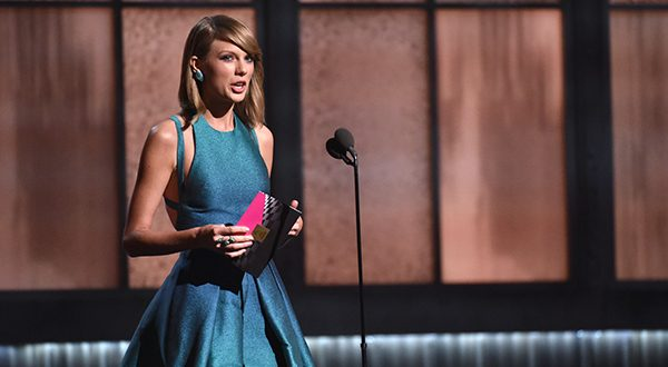 Taylor Swift presents the award for best new artist at the 57th annual Grammy Awards on Sunday, Feb. 8, 2015, in Los Angeles. (Photo by John Shearer/Invision/AP)