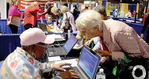 Revenue claims examiner Faye Johnson searches for one Maryland woman's name in the state comptroller's unclaimed property database at an October event at the Maryland State Fairgrounds in Timonium. (CNS/ANNIKA MCGINNIS)