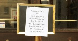 A sign posted at Baltimore's Mitchell Courthouse directs visitors to Courthouse East on Thursday. The Mitchell was closed due to a water main break a few blocks away on Lexington Street. (Daily Record photo by Danny Jacobs.)