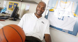 Former UCLA basketball player Ed O'Bannon Jr., shown in his Henderson, Nevada office in September 2010, was the first named plaintiff in the revenue-sharing suit on behalf of NCAA athletes. 'There are millions and millions of dollars being made off the sweat and grind of the student athlete,' O'Bannon said when the suit was filed. (AP Photo/Isaac Brekken)