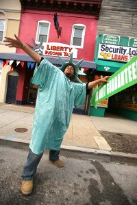 Quentin Lee, dressed as the Statue of Liberty, works in front of Liberty Income Tax on Eastern Ave. in Highlandtown Monday April 18, 2011.  (The Daily Record/Rich Dennison)