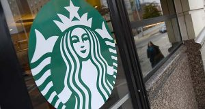 Starbucks logo at the coffee shop at St. Paul and Saratoga streets in Baltimore. (The Daily Record / Maximilian Franz)