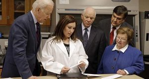Then-Vice President Joe Biden listens at left as Argie Majors, second from left, biology section manager at the Maryland State Police Forensic Science Laboratory, explains the contents of a sample rape kit, Monday, March 16, 2015, in Pikesville, Md. From left are, Biden, Majors are Sen. Ben Cardin, D-Md., Rep. Dutch Ruppersberger, D-Md., and Sen. Barbara Mikulski, D-Md. (AP Photo/Patrick Semansky)