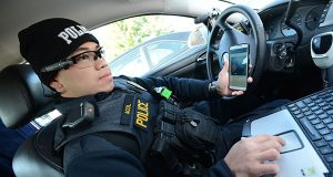 Officer Alfie G. Acol, with the Laurel Police Department, seen here at his squad car with his AXON Flex, head mounted-point of view video recording system. (The Daily Record/Maximilian Franz)